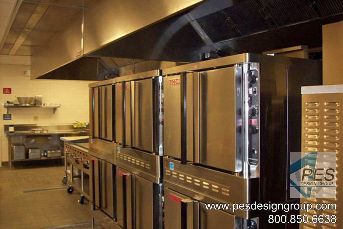 A bank of double deck convection ovens in a high school kitchen design