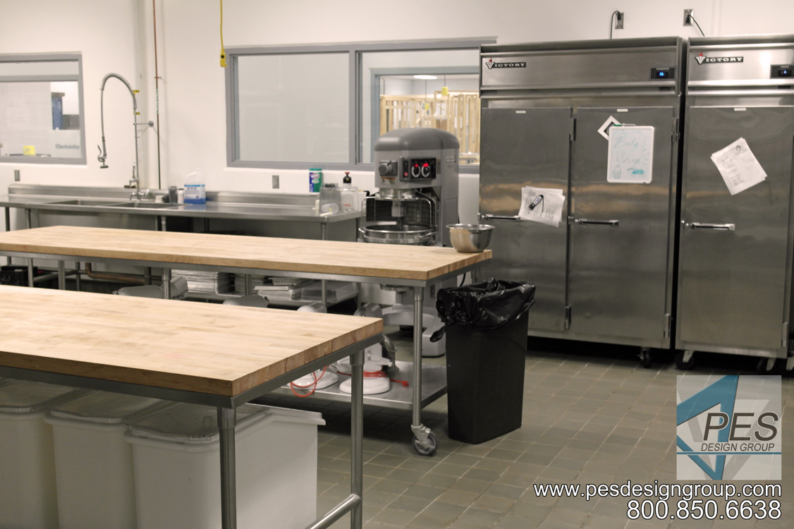 Prep tables and mixer in the bakery at Manatee Technical College's culinary teaching kitchen in Bradenton Florida.