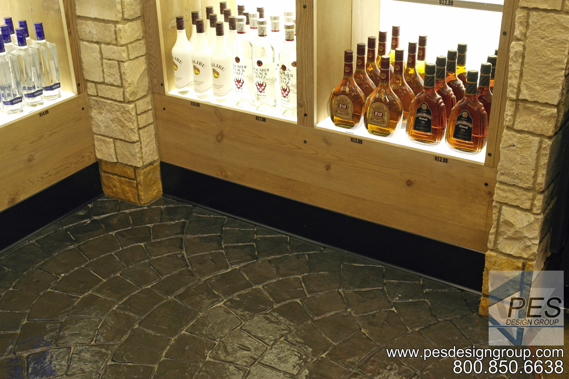Using reclaimed wood, stone, glass and stamped concrete in C-store design.