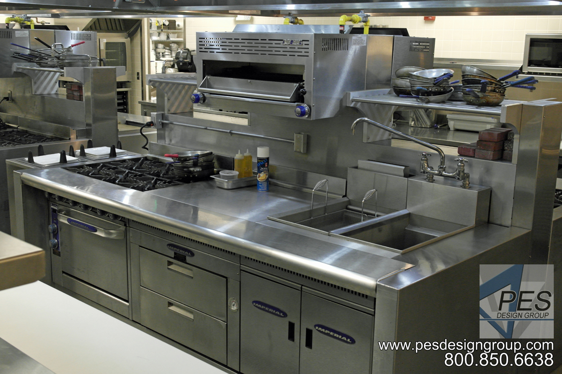 A range, pasta cooker and salamander broiler incorporated into a commercial island cooking suite in the Bistro 502 open kitchen.