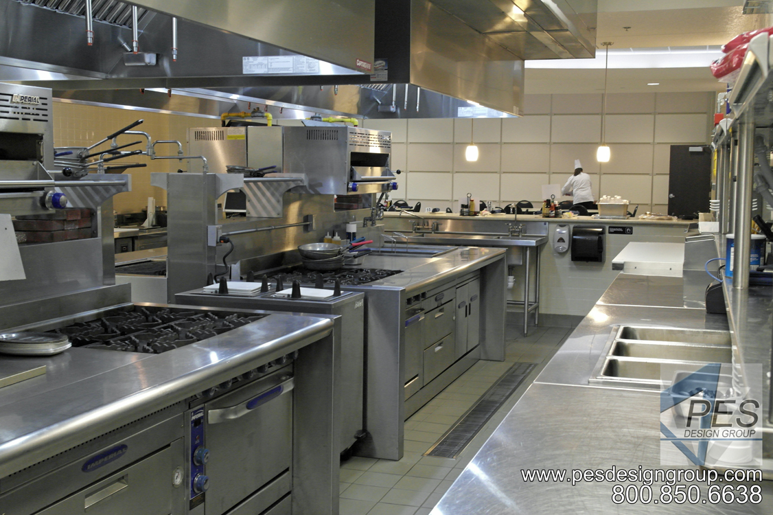 Commerical island cooking suites and expediting counter designed for the open kitchen concept of Bistro 502 in Sarasota Florida.