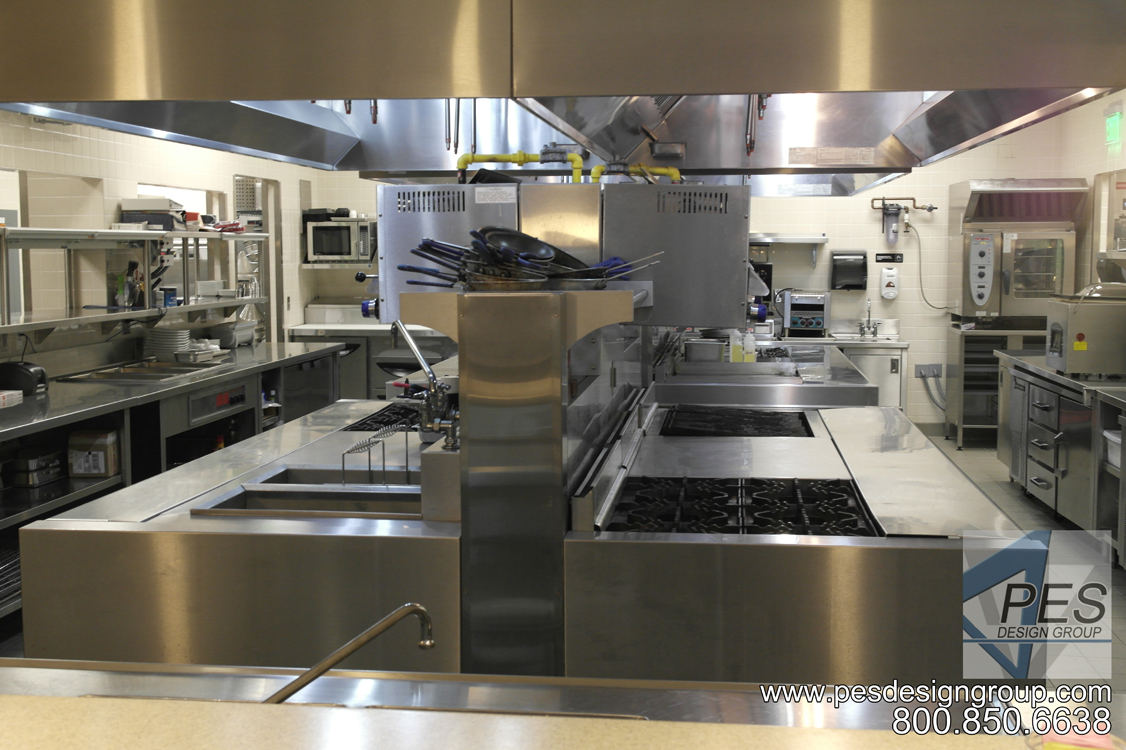 Commerical island cooking suite designed for the open kitchen concept of Bistro 502 in Sarasota Florida.