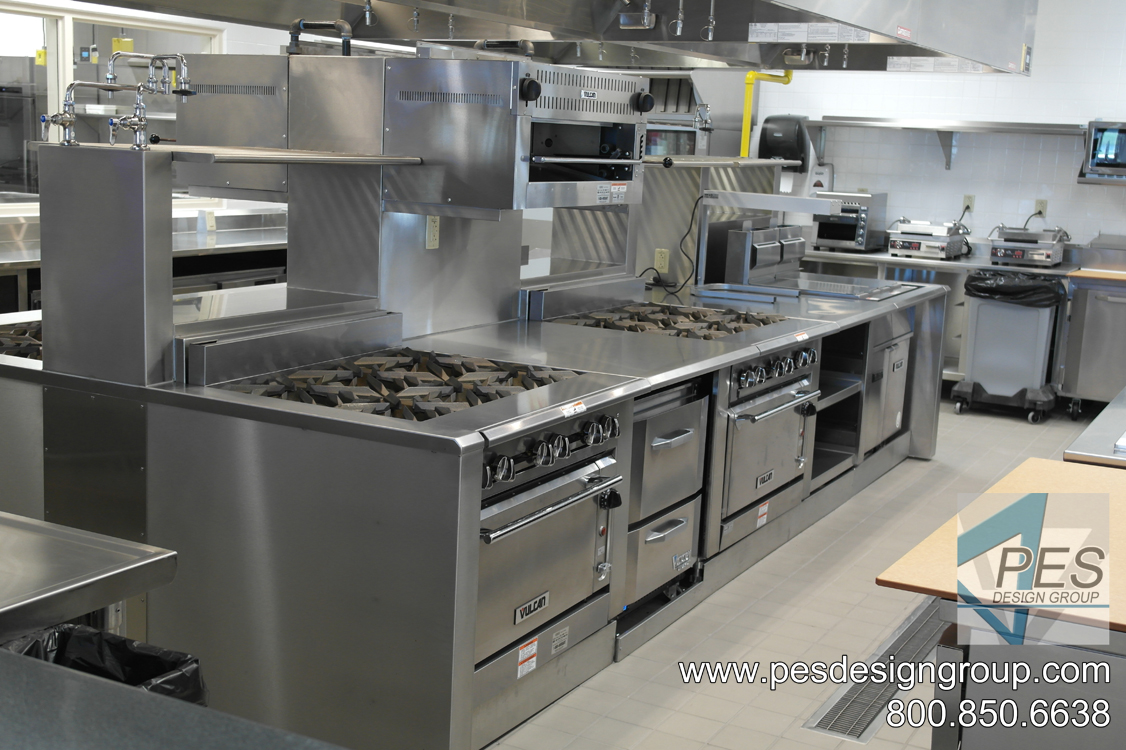 An island cooking suite featuring ranges and a fryer at Suncoast Technical College's culinary teaching kitchen in North Port, Florida.
