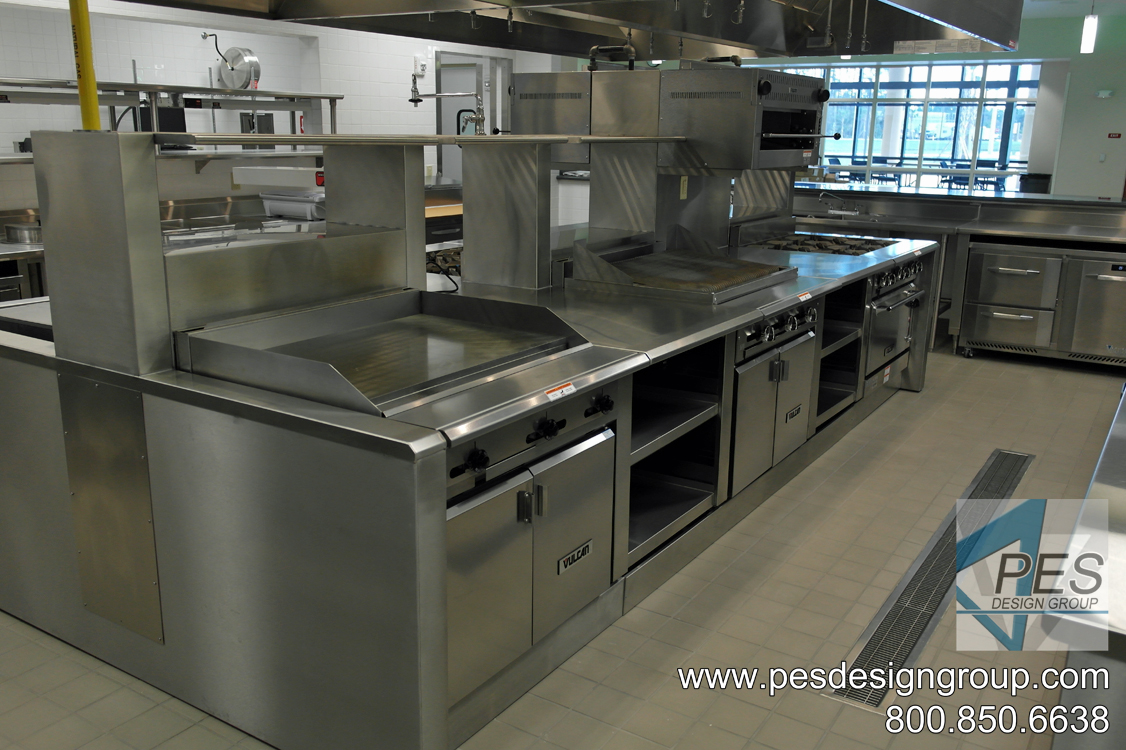 An island cooking suite featuring a range, griddle and charbroiler at Suncoast Technical College's culinary teaching kitchen in North Port, Florida.