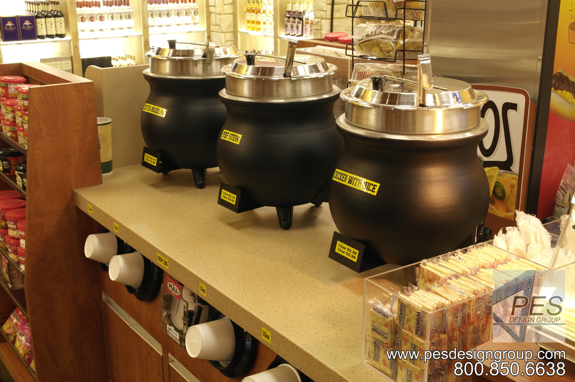 A self-serve c-store foodservice counter featuring soup kettles and built-in bowl dispensers.