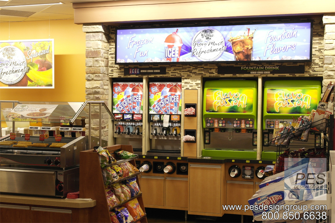 An attractive fountain beverage center with multi-flavor soda dispensers, frozen drink machines and built-in cup, lid and straw organizers.